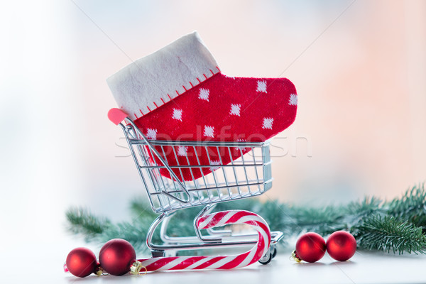 Shopping cart with christmas sock and lolipop  Stock photo © Massonforstock