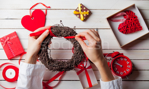 white caucasian female hands wrapping wreath near things for dec Stock photo © Massonforstock