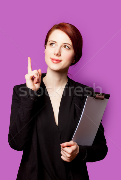 beautiful young woman with clipboard on the wonderful purple bac Stock photo © Massonforstock