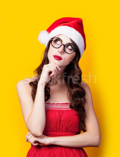 photo of beautiful young woman  in santa claus hat on the wonder Stock photo © Massonforstock