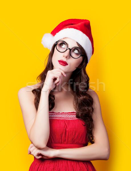 Fotografia piękna młoda kobieta Święty mikołaj hat zastanawiać się Zdjęcia stock © Massonforstock