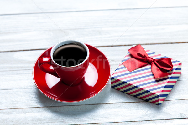 photo of cup of coffee and cute wrapped gift on the wonderful wh Stock photo © Massonforstock