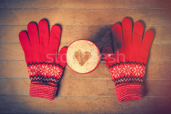 photo of cup of coffee and warm gloves on the wonderful brown wo Stock photo © Massonforstock