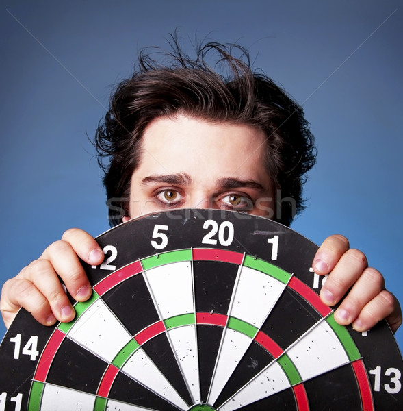 Stock photo: Emo boy with darts.