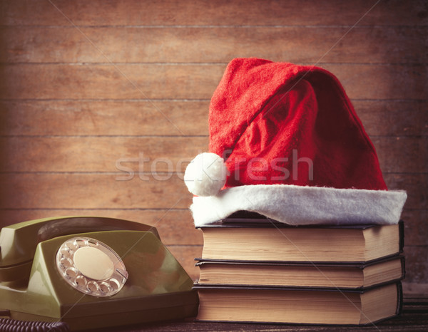 Santas hat over books near green dial phone  Stock photo © Massonforstock