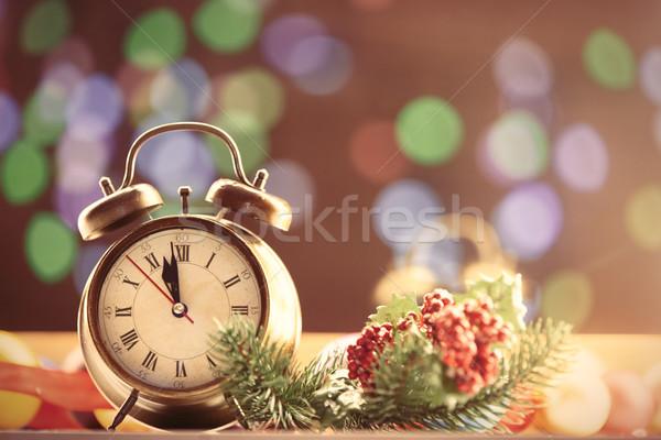 Clock and Christmas lights Stock photo © Massonforstock