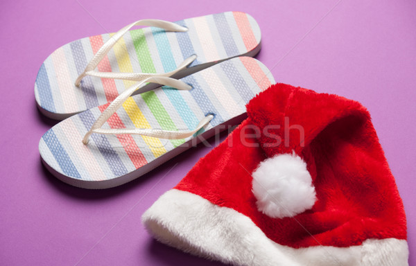 Santas hat and flip flops Stock photo © Massonforstock