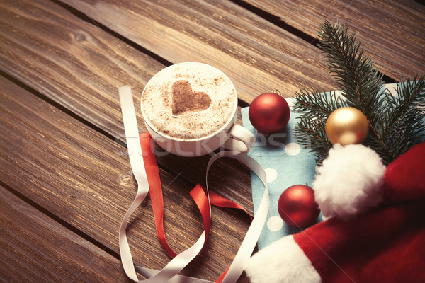 Christmas bubbles and Santas hat Stock photo © Massonforstock