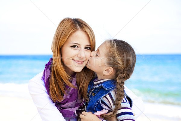 Stock photo: Two sisters 5 and 22 years old at the beach in sunny autumn day