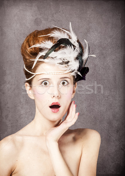 Surprised redhead girl with Rococo hair style at vintage backgro Stock photo © Massonforstock