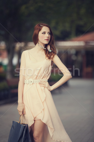 Young woman with shopping bags walking on the city street Stock photo © Massonforstock