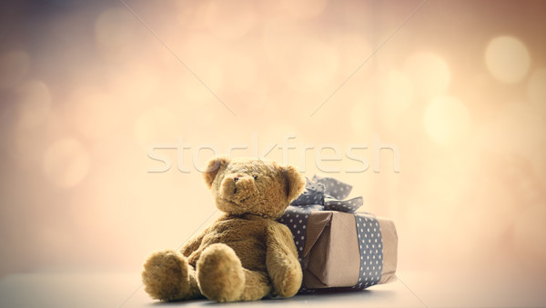 cute teddy bear and beautiful gift on the fairy lights bokeh bac Stock photo © Massonforstock