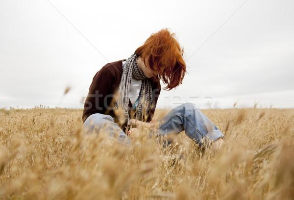 Eenzaam triest meisje veld gras vrouwen Stockfoto © Massonforstock