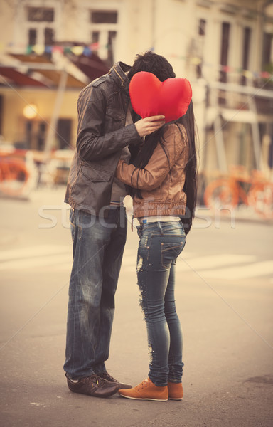 Young couple kissing on the street Stock photo © Massonforstock