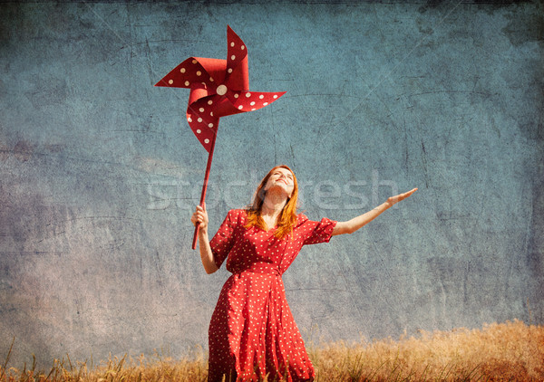 Girl with wind turbine at field Stock photo © Massonforstock
