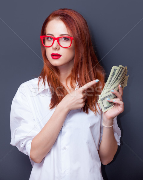 Stock photo: Portrait of a businesswomen in white shirt with money