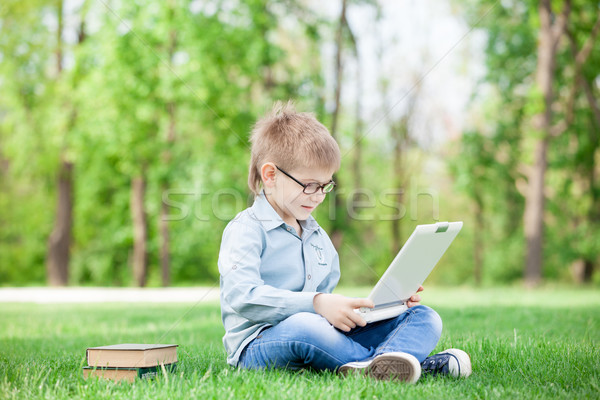 boy with a books and laptop computer  Stock photo © Massonforstock