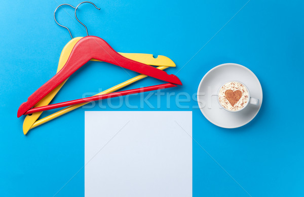 paper, cup and hangers lying on the table Stock photo © Massonforstock