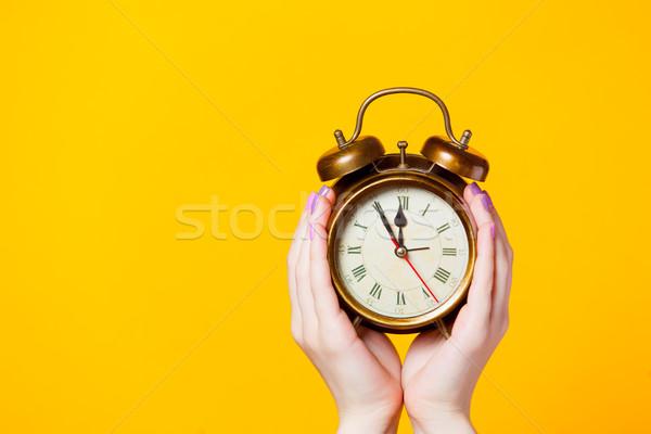 Fotó női kezek tart ébresztőóra csodálatos Stock fotó © Massonforstock