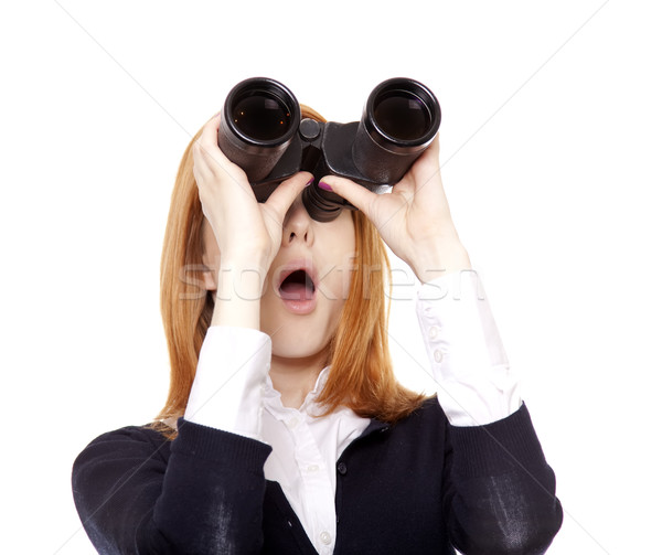 Business women seeking with binocular Stock photo © Massonforstock