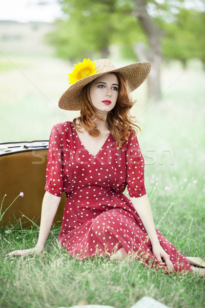 Redhead girl with sunflower at outdoor. Stock photo © Massonforstock