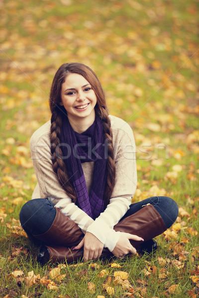 Smiling happy girl in autumn park. Stock photo © Massonforstock