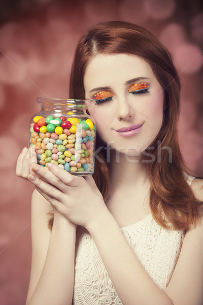 young woman holding a bowl full of jelly beans  Stock photo © Massonforstock