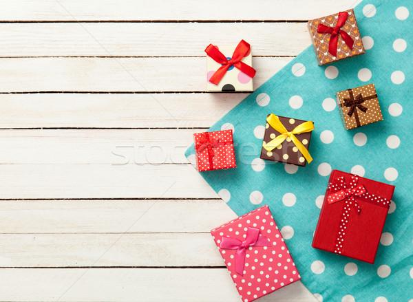 Gift boxes on napkin Stock photo © Massonforstock