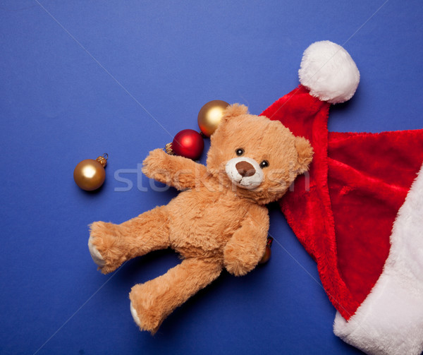 Teddy bear and Santa Claus hat  Stock photo © Massonforstock