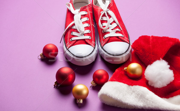 Gumshoes and Santas hat o Stock photo © Massonforstock
