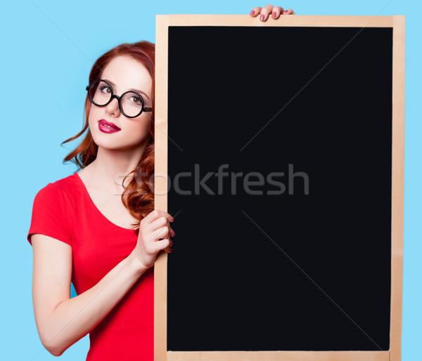 Сток-фото: девушки · красное · платье · доске · молодые · удивленный