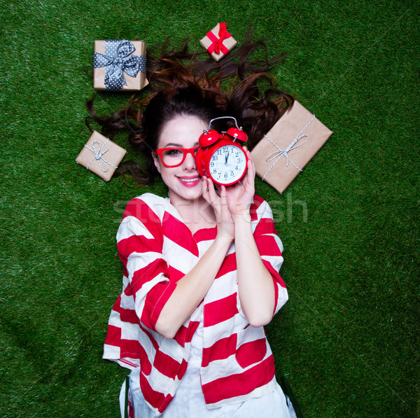Portrait of a young styled redhead woman alarm clock and gifts  Stock photo © Massonforstock