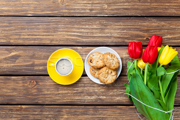 bunch of tulips, plate full of cookies and cup of coffee on the  Stock photo © Massonforstock