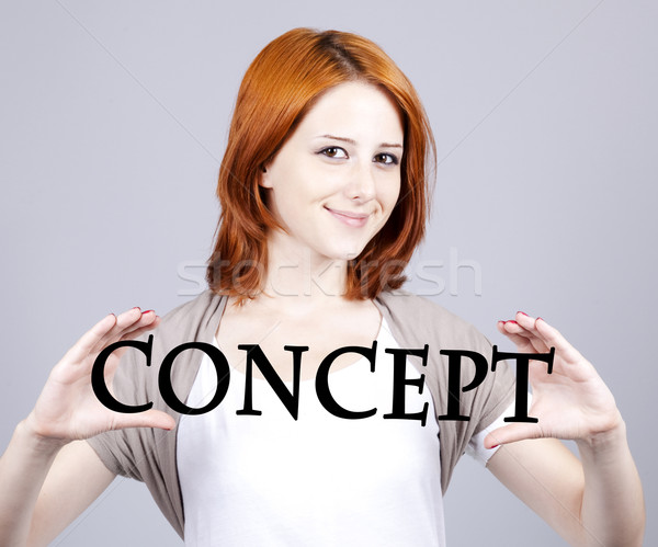 Red-haired businesswoman show abstract word 'concept''. Stock photo © Massonforstock