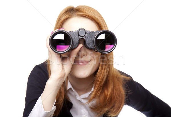 Business women seeking with binocular Stock photo © Massonforstock