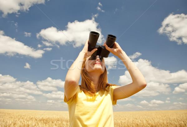 Redhead girl with binocular at wheat field. Stock photo © Massonforstock