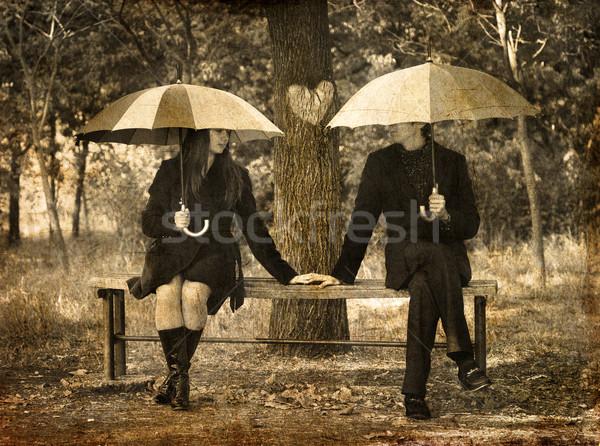 Dos sesión banco lluvioso día foto Foto stock © Massonforstock