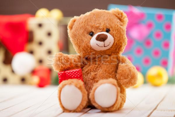 Küçük oyuncak ayı hediye Noel gülümseme kırmızı Stok fotoğraf © Massonforstock