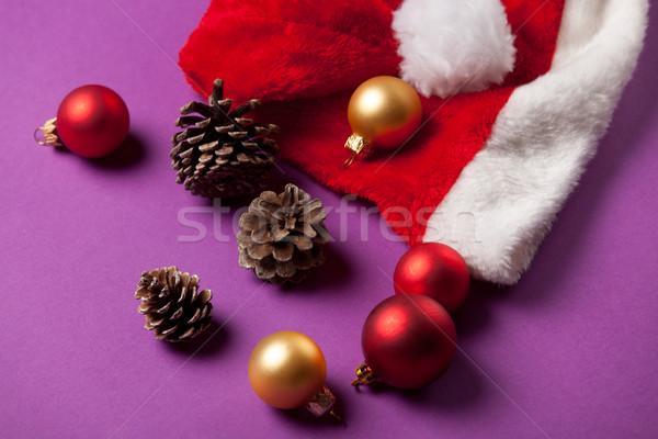 Pine cone and Santas hat  Stock photo © Massonforstock