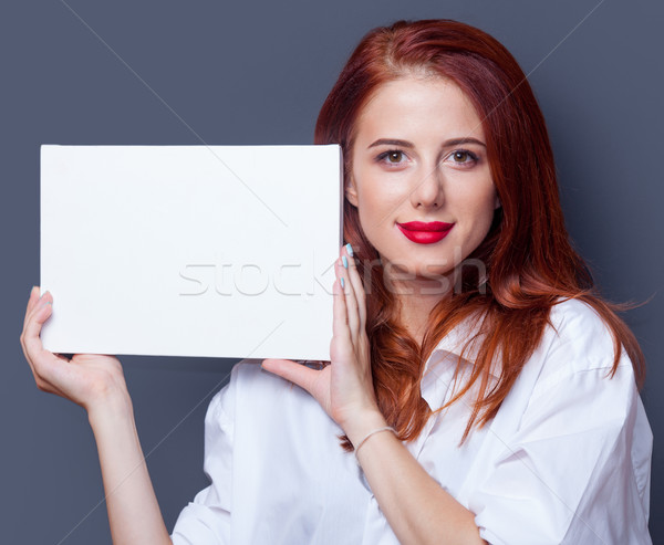 Stock photo: businesswomen in white shirt with board