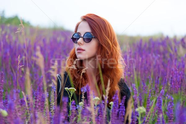 Belle jeune femme séance détente merveilleux floraison Photo stock © Massonforstock