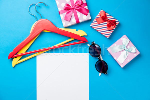 photo of empty sheet of paper, sunglasses, cute gifts and hanger Stock photo © Massonforstock