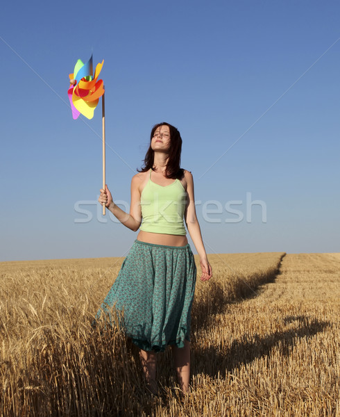 Girl with wind turbine at wheat field  Stock photo © Massonforstock
