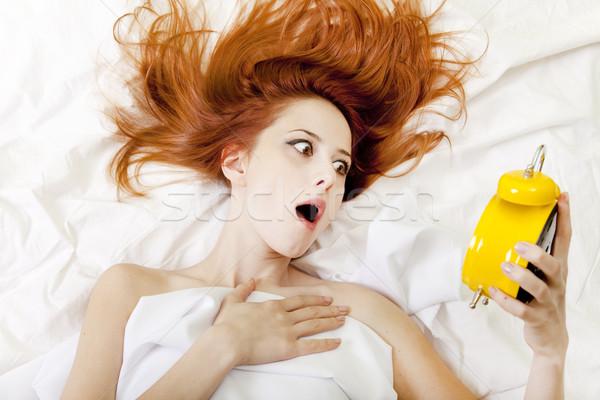 Oversleep girl in bed Stock photo © Massonforstock