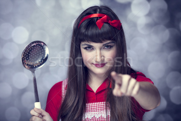 Brunette housewife with soup ladle Stock photo © Massonforstock