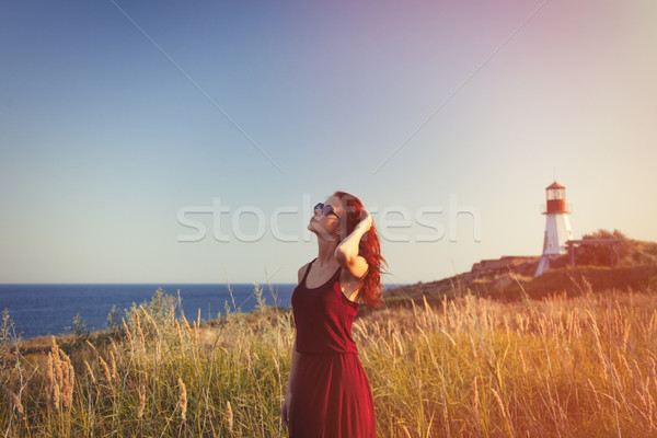 girl with sunglasses near Lighthouse Stock photo © Massonforstock