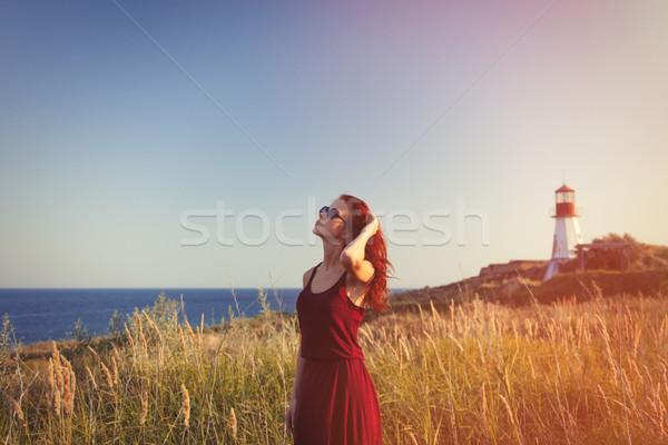 Meisje zonnebril vuurtoren jonge Blauw Stockfoto © Massonforstock
