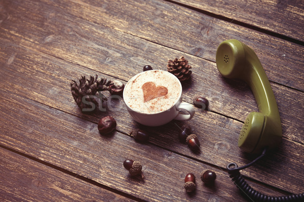 Cup of coffee with heart shape and green handset  Stock photo © Massonforstock