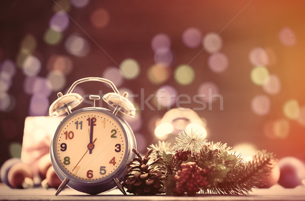 Clock and pine branch with Christmas lights  Stock photo © Massonforstock