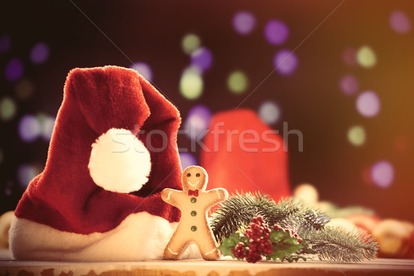 Santas hat and gingnerbread  Stock photo © Massonforstock